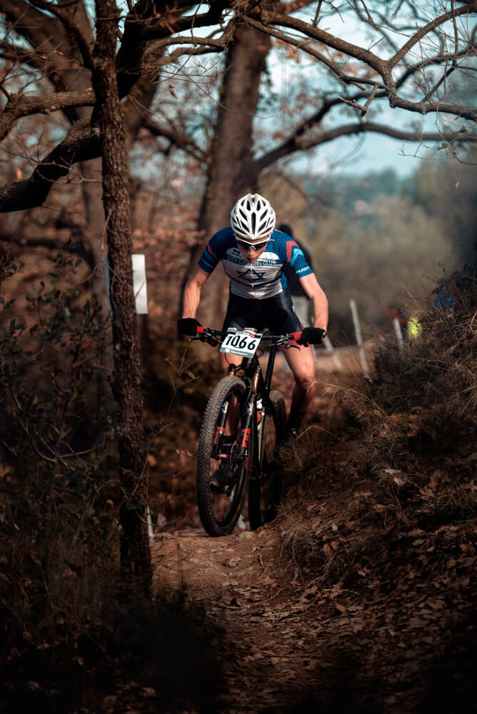 Mountain bike racer coming up hill