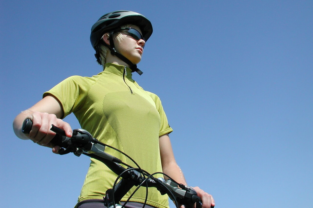 Woman looking out while on bike