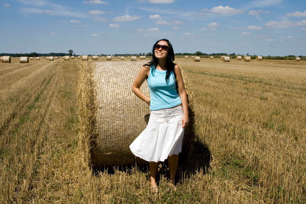 Woman by a hay bale